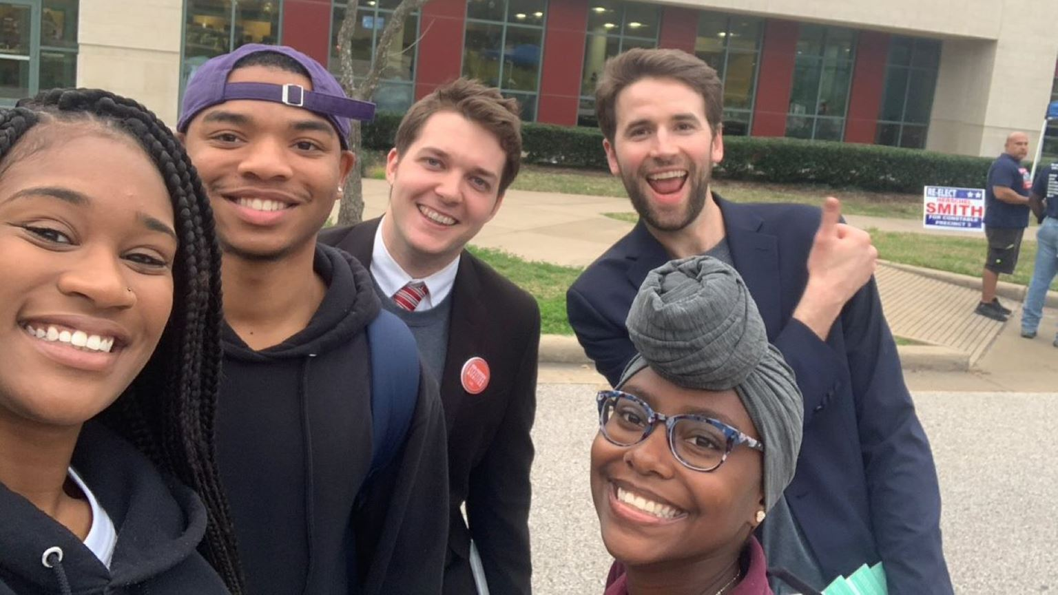 Young volunteers outside of a polling location